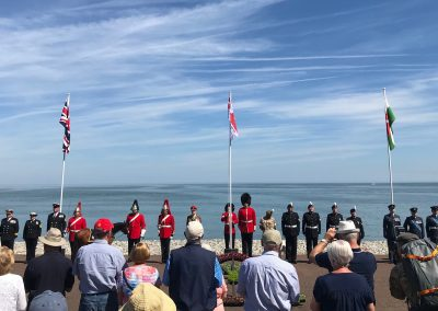 Change Step helps to raise Armed Forces Day flag